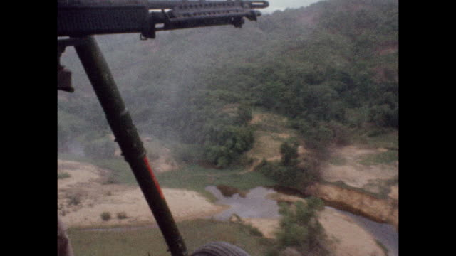 soldier fires from helicopter mounted gun during the vietnam war in combat zone near the 17th parallel in 1966. - healthcare and medicine or illness or food and drink or fitness or exercise or wellbeing stock videos & royalty-free footage