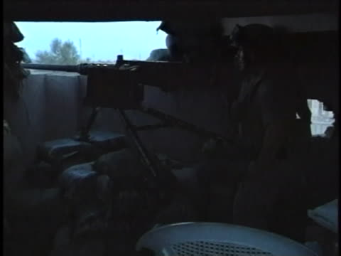 soldier fires his machine gun from inside a bunker. - al fallujah stock videos & royalty-free footage
