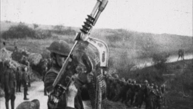 stockvideo's en b-roll-footage met soldier firing machine gun and heavy artillery fires / france - machinegeweer