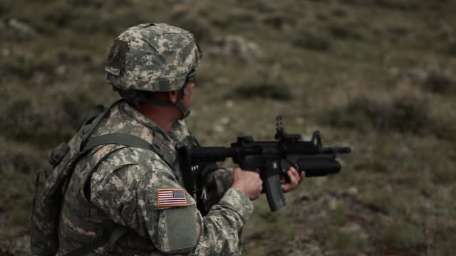 soldier firing the grenade launcher on his rifle at a range. - one mid adult man only stock videos & royalty-free footage