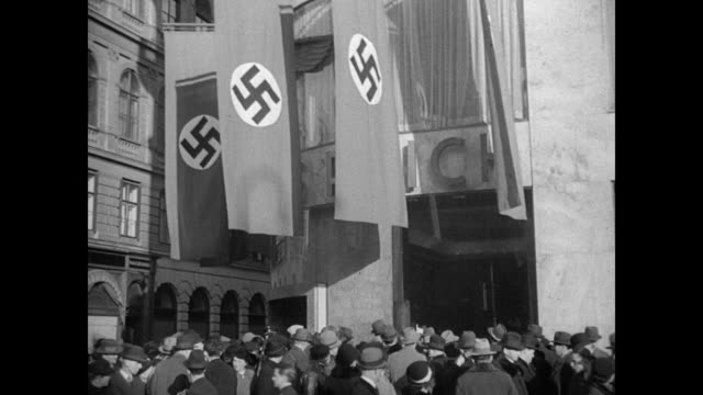 soldier for radio 'all laws of the third reich effective immediately' nazi banners hanging above peoples heads / street vendors w/ photographs of... - judaism stock-videos und b-roll-filmmaterial