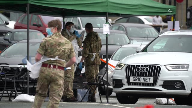 soldier from the duke of lancaster's regiment, instructs people arriving at a pop-up mobile covid-19 testing centre on april 29, 2020 in... - army stock videos & royalty-free footage