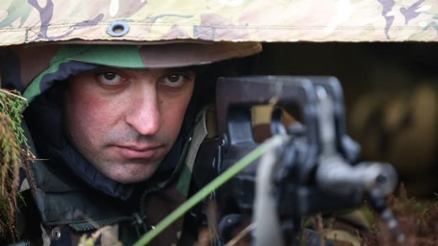 a soldier from the french army mans an observation point during an exercise with the royal artillery on february 20 2013 in otterburn united kingdom... - esercito militare francese video stock e b–roll