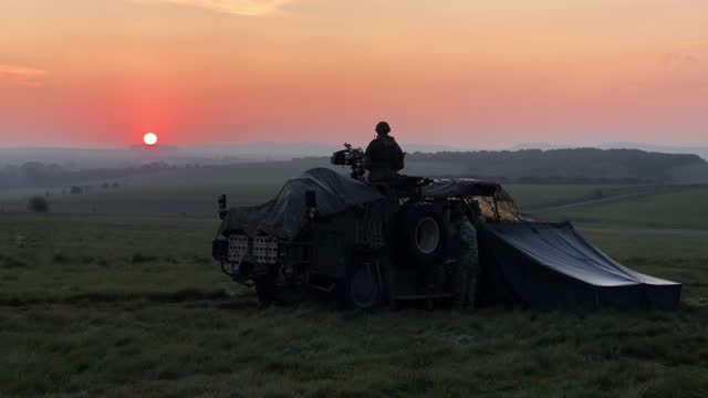 soldier from the uk task group guards the perimeter of the camp from a coyote tactical support vehicle at sunrise during a mission rehearsal exercise... - atlantic islands stock videos & royalty-free footage