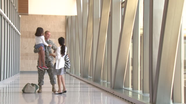 Soldier greeting family in airport