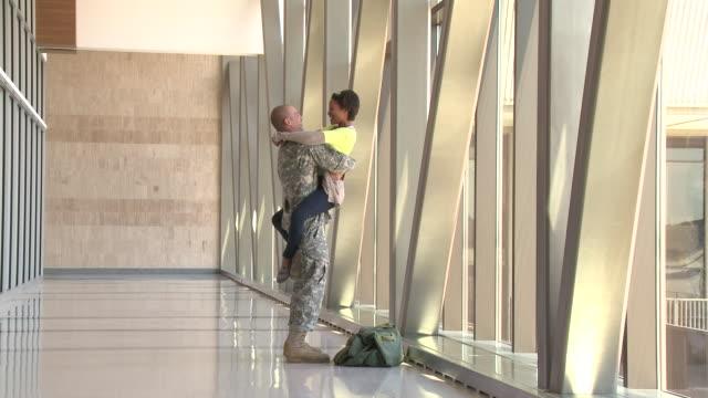 Soldier greeting girlfriend in airport