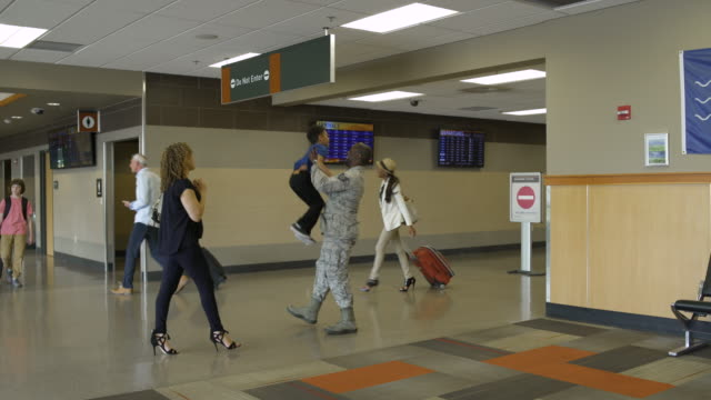 Soldier greeting his family at an airport