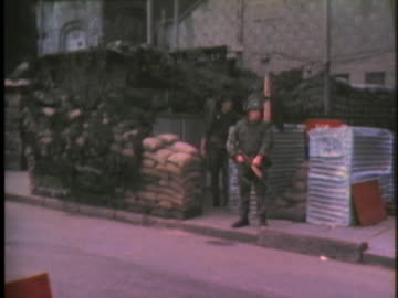 soldier guards the peace line between protestants and catholics in belfast - war or terrorism or military stock videos & royalty-free footage