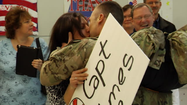 soldier has an emotion reunion with his wife at bwi airport on march 03 2012 in baltimore md - young war veteran stock videos & royalty-free footage