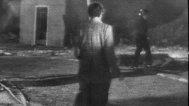 vídeos y material grabado en eventos de stock de 1957 b/w montage soldier helps survivors into a truck amidst devastation / united kingdom - 1957