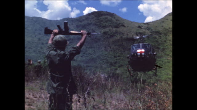 soldier holding up m16 to guide in a medevac helicopter - m16 stock videos & royalty-free footage