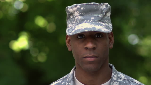 sm cu portrait soldier in cap looking down/ soldier looking up to stare into camera/ chicago, il - military uniform stock videos & royalty-free footage