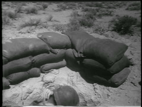 soldier in foxhole in desert before h-bomb explosion / yucca flats, nevada / newsreel - 1952 stock videos & royalty-free footage