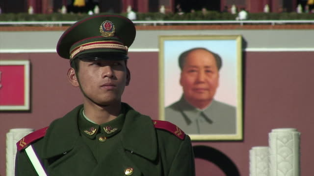 cu soldier in front of mao zedong portrait, beijing, china - alertness stock videos & royalty-free footage