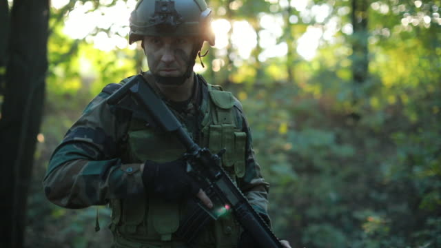 soldier in the forest - camouflage clothing stock videos & royalty-free footage