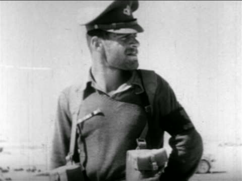 soldier in uniform turning to look behind him outdoors / middle east / suez crisis - 1956 stock-videos und b-roll-filmmaterial