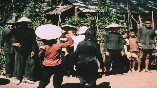 soldier interpreting to gathering villagers that the troops arriving are friendly / vietnam - megaphone stock videos & royalty-free footage