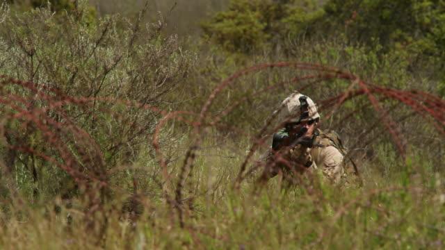 WS Soldier kneeling behing barbed wire AUDIO / Camp Pendleton, CA, United States