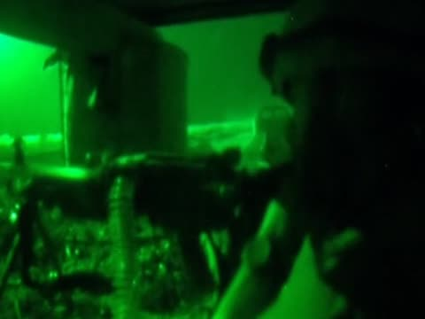 a soldier loads a gun and fires during the conflict in afghanistan at night - 2001年~ アフガニスタン紛争点の映像素材/bロール