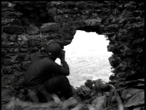 soldier looking through binoculars through hole in rubble / italy - rubble stock-videos und b-roll-filmmaterial