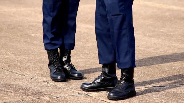 soldier marching low angle view - fare la guardia video stock e b–roll