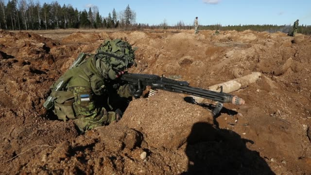 a soldier of the estonian defence forces fires his machine gun to defend his position during a joint military combat exercise with us army troops on... - estonia stock videos & royalty-free footage