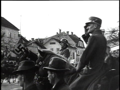 soldier on a horse saluting / german troops marching in the street / woman cheering in the crowd / german troops moving through the street - axis powers stock videos & royalty-free footage
