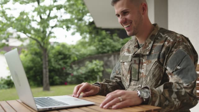 soldier on a mission talking to family on video call - military stock videos & royalty-free footage
