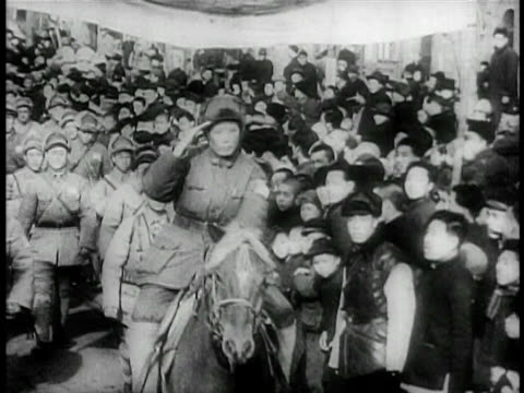 B/W 1949 soldier on horse riding past crowd in parade saluting / China / educational