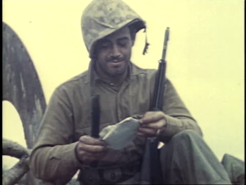 soldier opening letter with a knife / iwo jima, japan - battle of iwo jima stock videos & royalty-free footage
