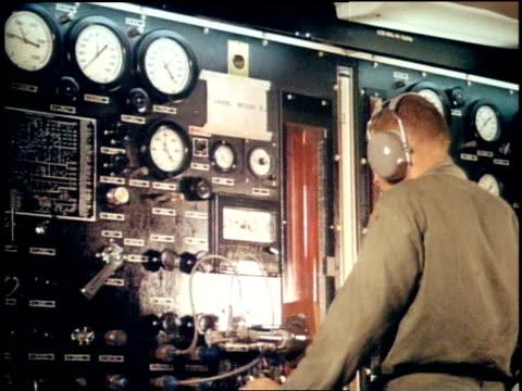 montage soldier operating electronic communications equipment / vietnam - handhaben stock-videos und b-roll-filmmaterial