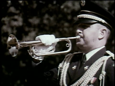 1965 montage soldier plays bugle in military ceremony at cemetery as old man places hand on headstone - bugle stock videos and b-roll footage