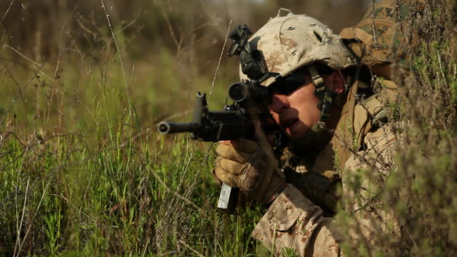 CU Soldier pointing gun towards AUDIO / Camp Pendleton, CA, United States