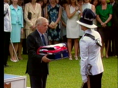 soldier presents former hong kong governor christopher patten a folded british flag. - hong kong flag stock videos & royalty-free footage