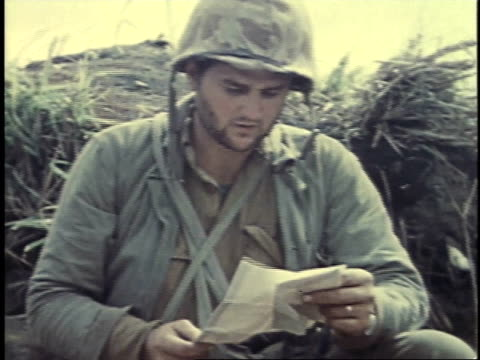 soldier reading letter / iwo jima japan - battle of iwo jima stock videos and b-roll footage