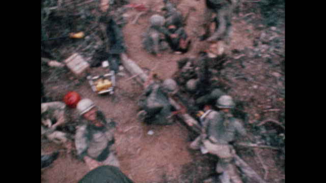 soldier repels down into a group of soldiers during vietnam war as wounded troops are evacuated from combat zone near the 17th parallel in 1966. - healthcare and medicine or illness or food and drink or fitness or exercise or wellbeing stock videos & royalty-free footage