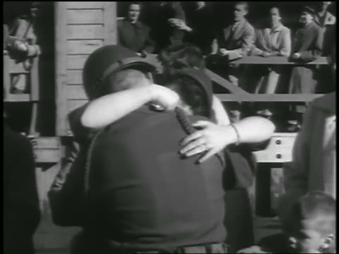 b/w 1954 soldier returning from korean war hugging kissing woman outdoors / seattle - 1954 stock videos and b-roll footage