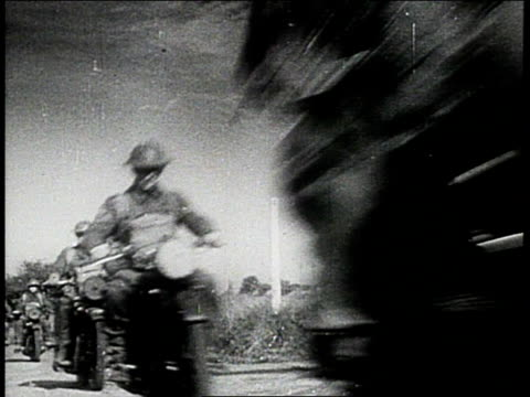 vídeos de stock, filmes e b-roll de soldier riding in tank / soldiers riding motorcycles / soldiers riding down road in convoy of trucks / soldiers riding in motorcycles with sidecars /... - forças aliadas