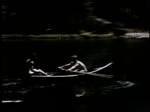 vidéos et rushes de ws soldier rowing boat with a woman sitting across from him / germany - bateau à rames