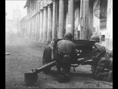 us soldier runs down manila street during world war ii street battle / filipino with a revolver and soldiers in doorway of house / montage street... - satchel stock videos & royalty-free footage