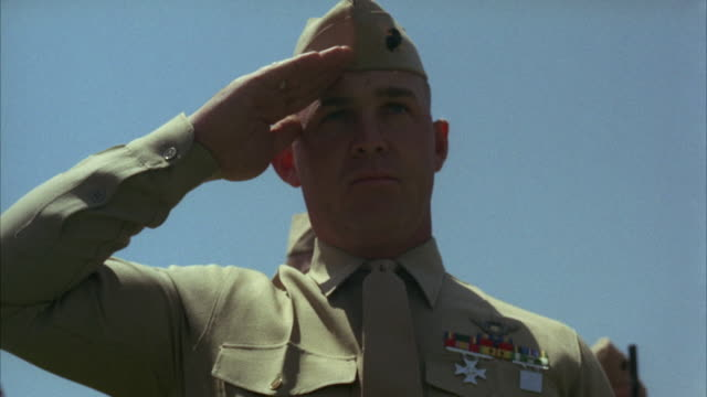 1967 cu la soldier saluting, standing against clear sky - saluting stock videos & royalty-free footage