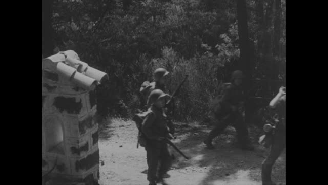 soldier searching german prisoners standing in line / close view of german prisoner holding white flag / three shots of german prisoners walking down... - world war ii video stock e b–roll