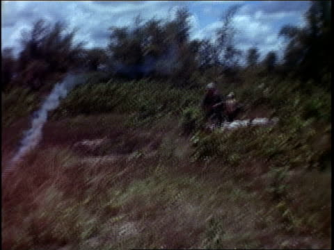 soldier setting off flare, then directing landing helicopter / vietnam - directing stock videos & royalty-free footage