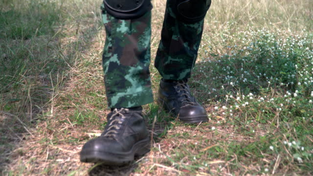 soldier shoes while walking in unknown area