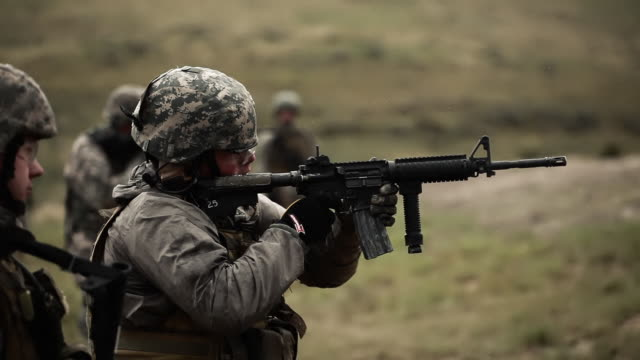 Soldier shooting an M4 rifle