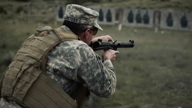 soldier shoots a sterling submachine gun - submachine gun stock videos & royalty-free footage