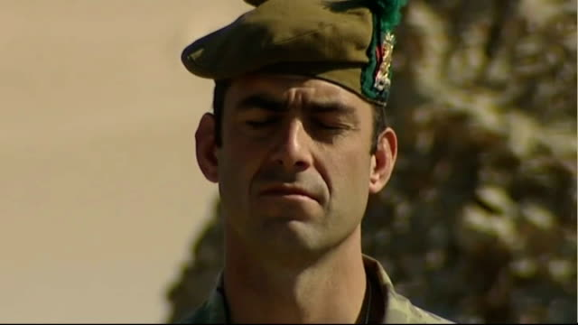 soldier showing written translation of armistice day service to local afghan police chief soldier standing for two minute silence at armistice day... - セキュリティスキャナ点の映像素材/bロール