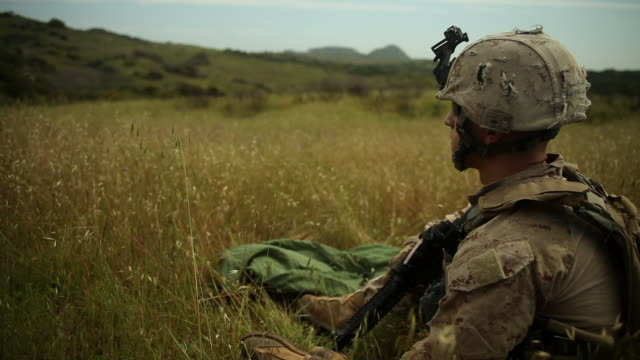 ms soldier sits and looks out over vast green hills audio / camp pendleton, ca, united states - army soldier stock videos & royalty-free footage