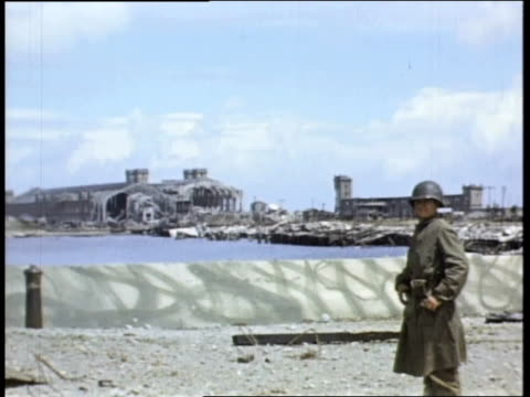 soldier standing at cherbourg's destroyed docks and port; narrated by jack lieb / cherbourg, france - narrating stock videos & royalty-free footage