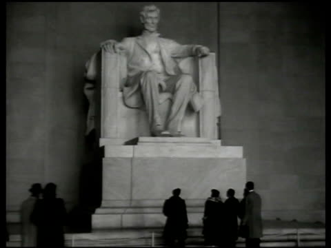 Soldier standing guard street Lincoln Memorial BG MS INT Lincoln Memorial w/ people standing in front of statue Statue w/ inscription behind WS US...
